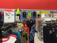 Bishop Police Officer Scida shopping with kids