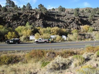 Photo of overturned big rig on side of road