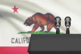 Image showing a podium in front of the CA State Flag